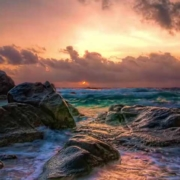 Ocean Sky and Sunset waves crashing on rocks
